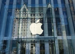 Apple hits $1 trillion mark, turns Nasdaq positive